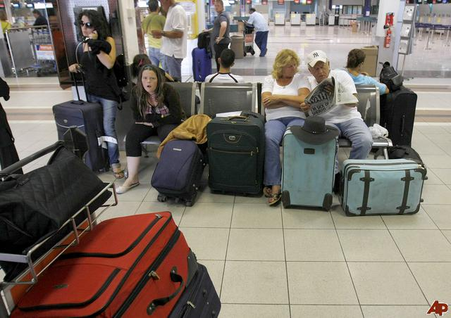 Passengers stranded by the collapse of XL Leisure Group are seen at Larnaca airport, Cyprus, Friday, Sept. 12, 2008. Thousands of British travelers are stranded as the country's third-largest tour operator has collapsed under pressure from high fuel prices and a sagging economy. XL Leisure Group PLC went into administration overnight, saying it had been unable to secure more funding. (AP Photo/Petros Karadjias)