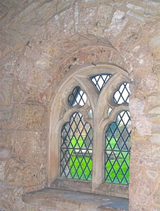 A Norman window set in a older Saxon door in parish church of Sts Andrew and Bartholomew, Ashleworth,