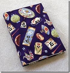 Agenda de mesa com capa de tecido