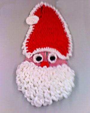 Cd recoberto com crochê ganha feição de Papei Noel