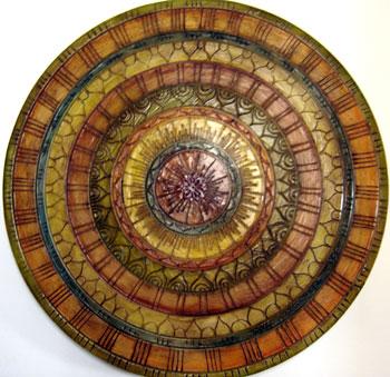 Mandala trabalhada em faixas de cores e texturas