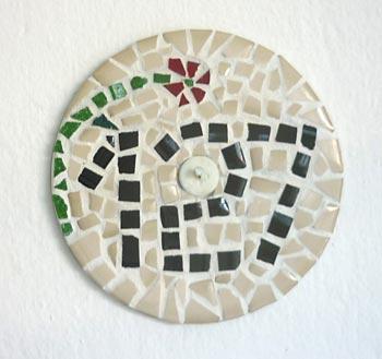 Mosaico elaborado sobre um CD reciclado