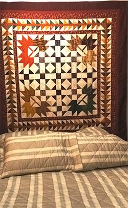 Colcha em patchwork usada como panô