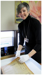 Jill Shea scans a newspaper for the World War I project at Haldimand County. Photo Credit: Knowledge Ontario