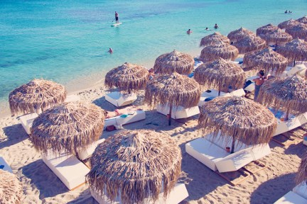 Comfortable sunbeds in Psarou beach