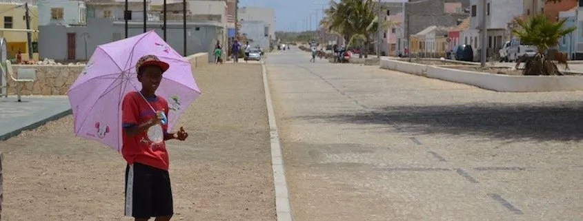 Boy with umbrella, Maio, Cape Verde