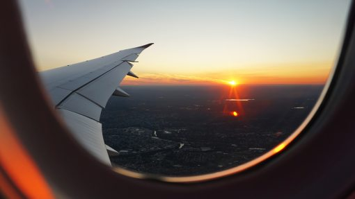 flying with an airplane sunset