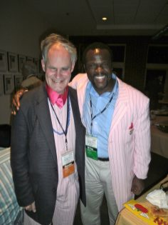 Trading coats with Far-Flung Correspondent Omar P.L. Moore.