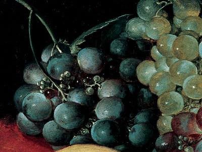 Détail du tableau Nature morte avec fruits, noix et fromage de Van Dyck. Trois types de raisin et leur traitement chromatique respectif pour un rendu précis et équilibré.