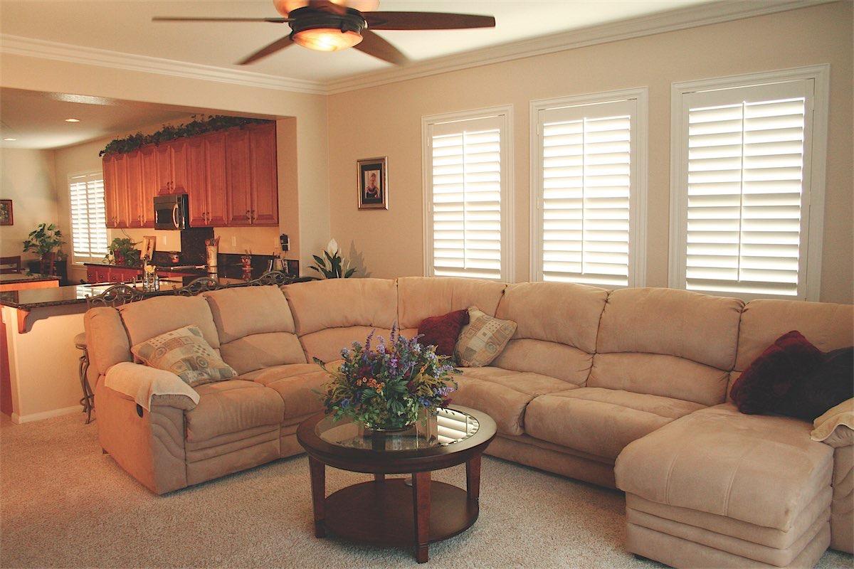 White Shutters In Living Room Vineyard Blinds