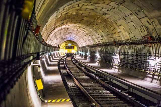 photo of train track subway