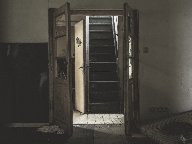 Door opening to a staircase. A old home, looking dirty. Image used for jayanthy's free space for Fiction Monday