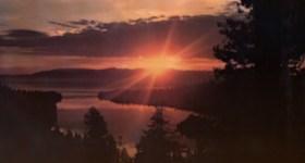 Vintage Lake Tahoe Postcard showing the sunrise over Emerald Bay
