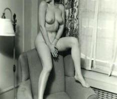 Vintage nude sitting on arm chair