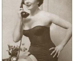 Corseted girl on telephone