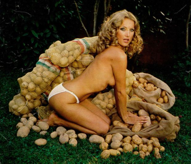 Barbara Bouchet with stacks of potatoes