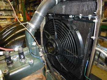 With the electric fan now fitted it was time to test run the engine. The result was amazing. Temperature was controlled even without the ram air factor. Ram air is the term used for the air that is pushed through the radiator as the car is driven down the road. Some race cars do not have fans at all. Another reason for my Davies Craig set up is that it only operates when needed whereas a belt driven fan works all the time and robs power from the engine. When on constant drives 'ram air' is all that is needed to keep the engine cool. Older cars always had the fan running and robbing vital horsepower.