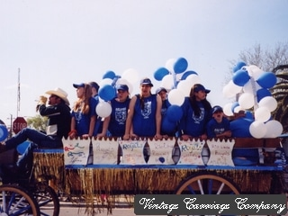 Home coming parade with large Wagonette