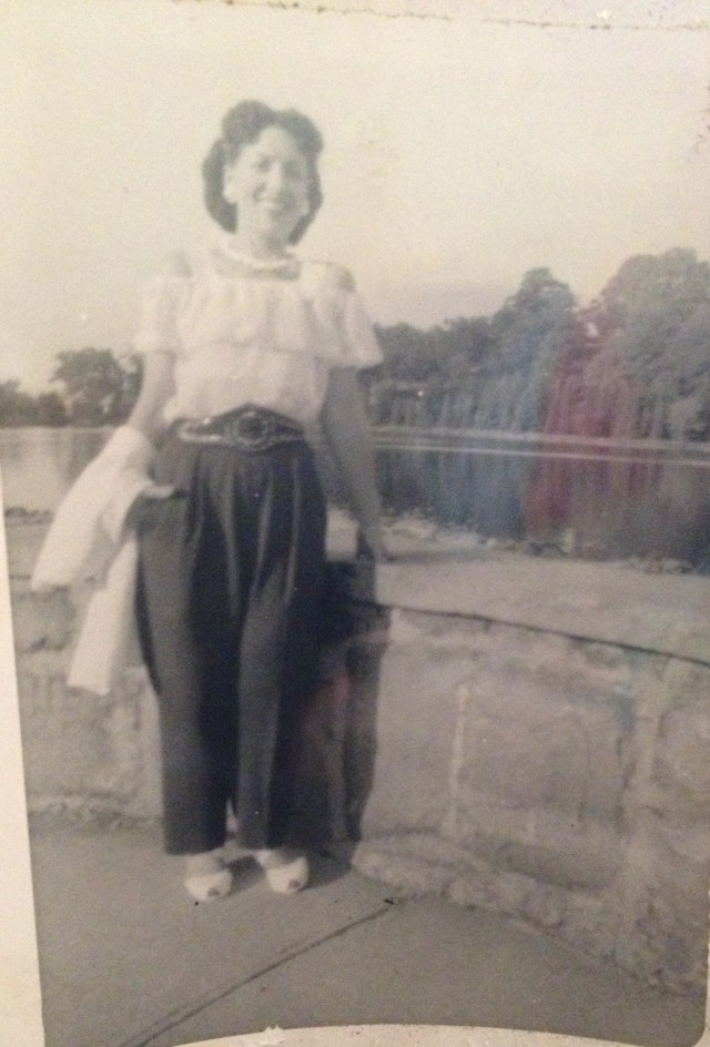 1950s woman in pants and spanish style blouse