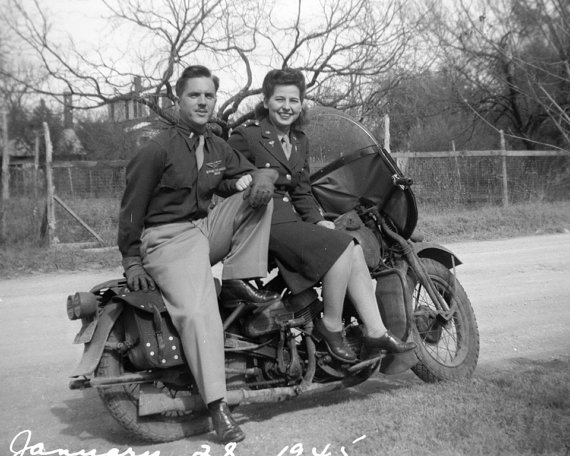 1940s vintage image of a wartime couple on a motorcycle