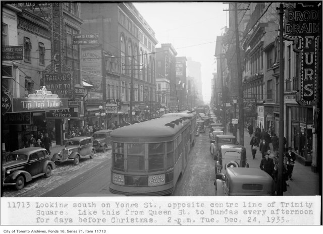 Looking south on Yonge St, opposite centre line of Trinity Square; like this from Queen St, to Dundas, every afternoon for days before Christmas; 2 p.m., Tuesday, December 24, 1935, (Traffic Study Department)
