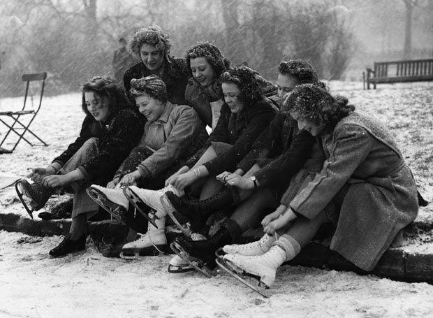 1947 women putting on ice skates vintage image