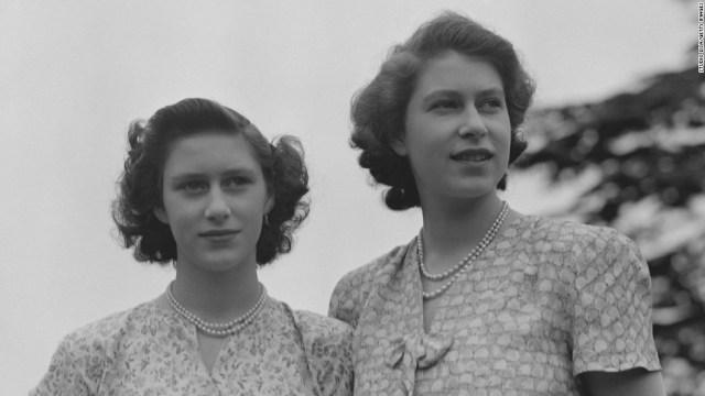 Queen Elizabeth II and Princess Margaret wearing summer dresses, circa 1942.