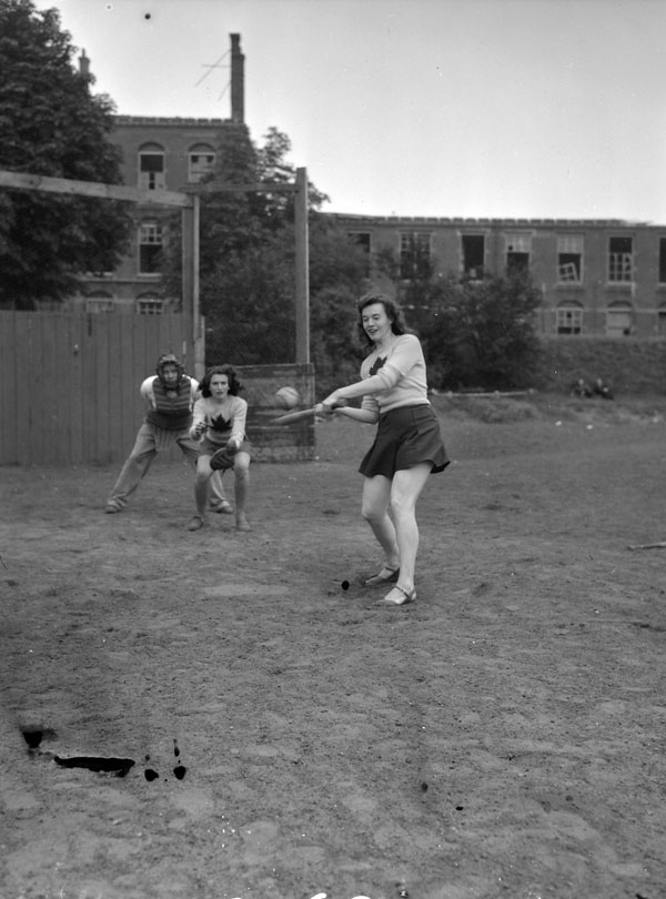 "Baseball game between women from the ""Eager Beavers"" and officers of the Regina Rifle Regiment 1940s"