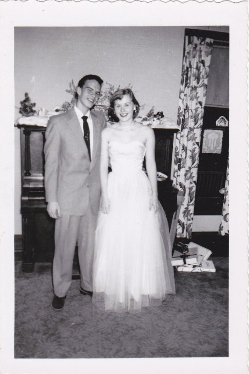 1950s couple dressed for winter formal vintage image