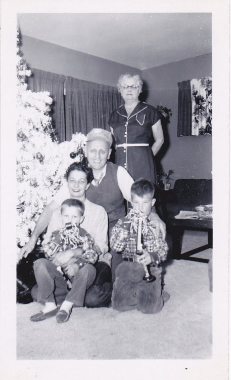 1950s family vintage photo with white christmas tree