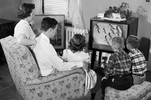 1950s vintage image of a family watching tv