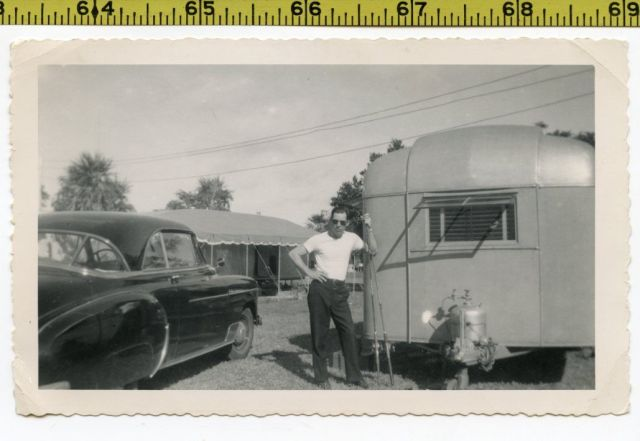 Vintage 1940's photo of vintage trailer and car and man with fishing poles