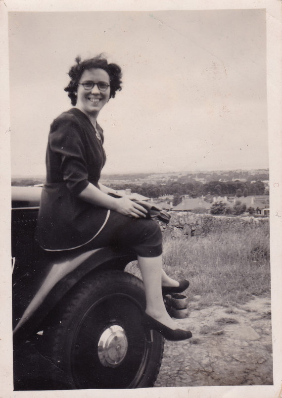 Smiling Young Lady Sitting On Car - Vintage c1940s Snapshot Photo