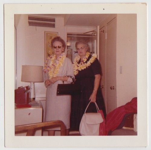 1960s mature women wearing leis hawaiian vacation vintage image