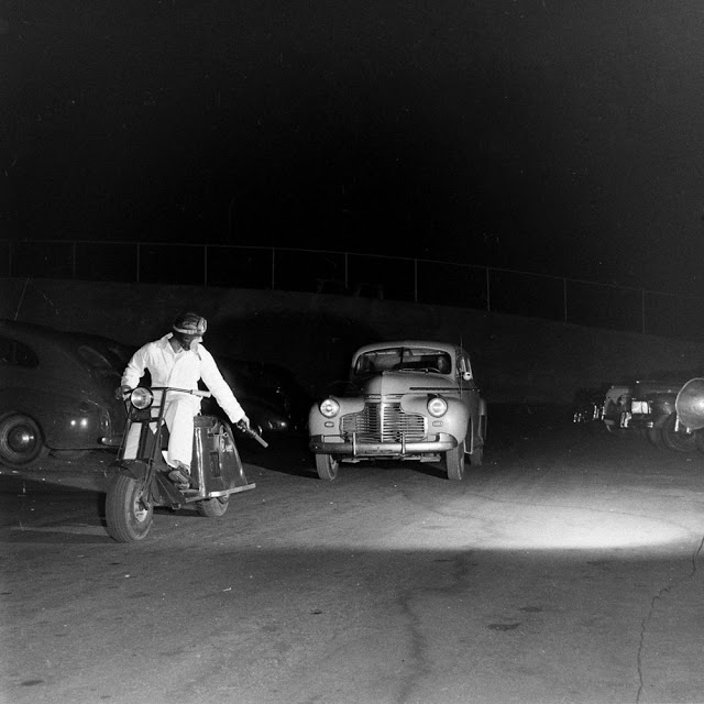 drive in theatre 1948 San Francisco usher on a motorcycle