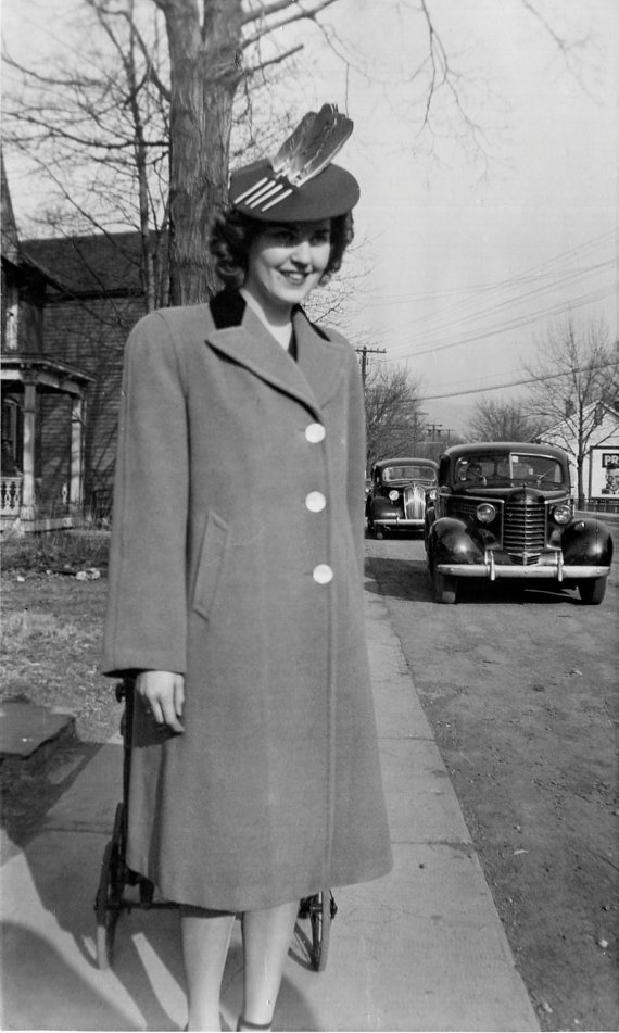 1940s vintage photo of woman in hat with feathers