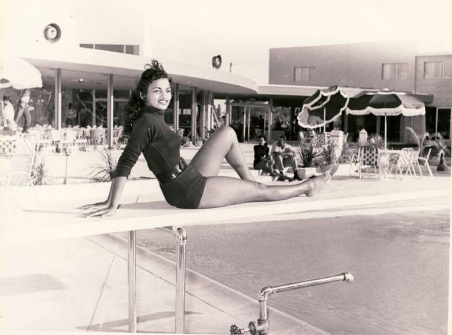 Photograph of a showgirl posed at the swimming pool of Moulin Rouge Hotel and Casino, [May 22], 1955