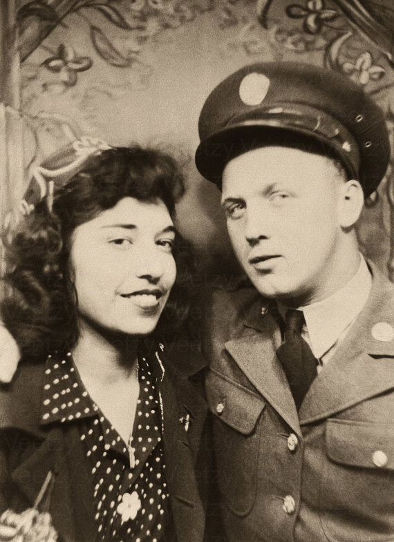 vintage photo 1950s young woman and soldier in photobooth