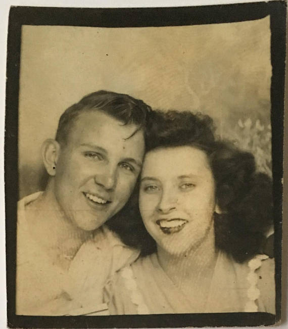 vintage photobooth image of young couple in love