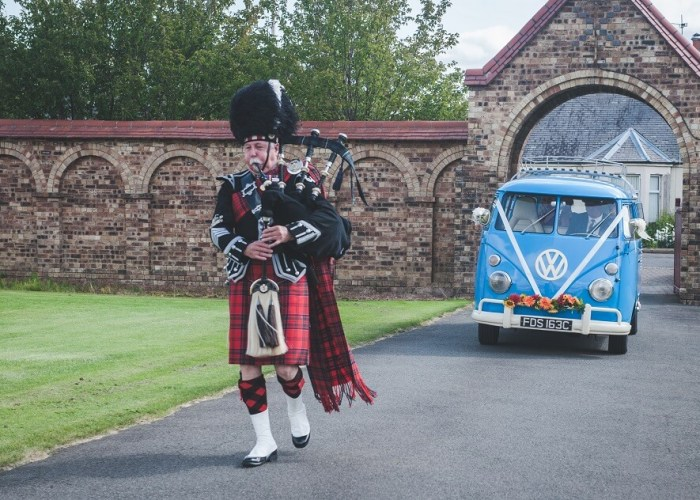 Bagpiper in Scotland by Green Wedding Photography