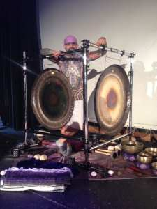 Marshall Bendelac behind sound healing instruments Saturn and Sun Paiste Planetary Gongs.