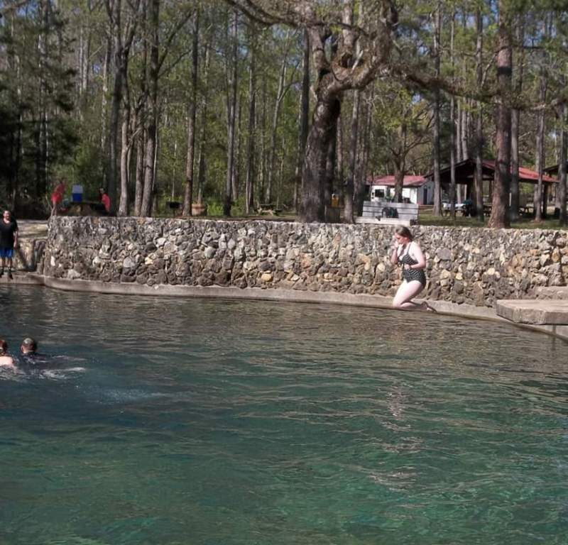 Violet Sky jumping into water at Ponce de Leon Springs State Park, Florida