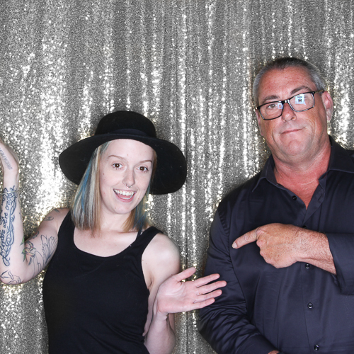 Father and daughter posing at the party photo booth