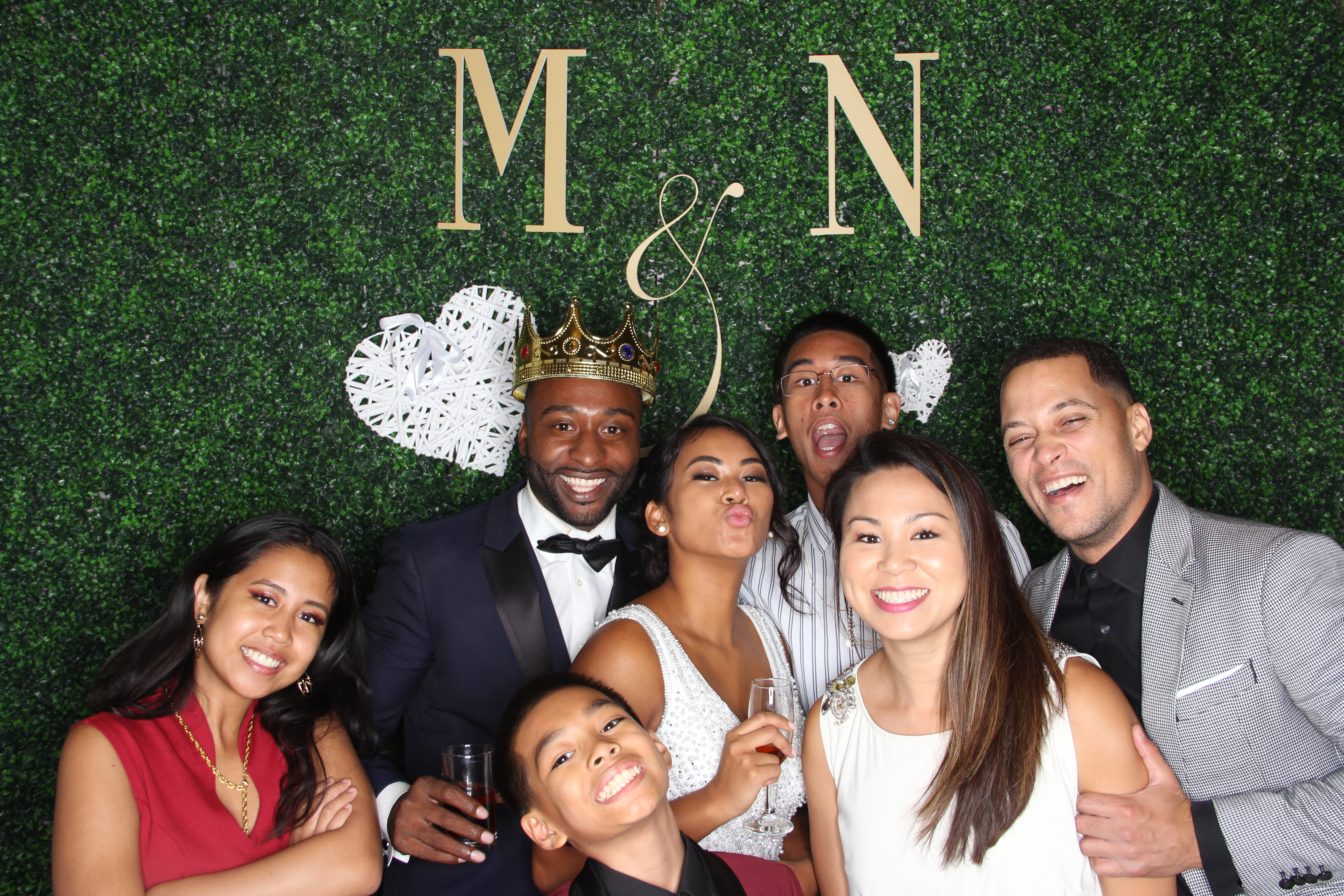 Groom and friends in the photo booth at a wedding
