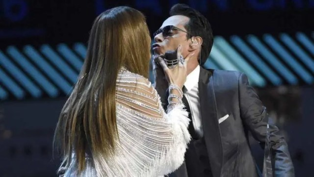 Jennifer Lopez, left, kisses Marc Anthony after presenting the person of the year award at the 17th annual Latin Grammy Awards at the T-Mobile Arena on Thursday, Nov. 17, 2016, in Las Vegas. (Photo by Chris Pizzello/Invision/AP) 2016 Latin Grammy Awards - Show