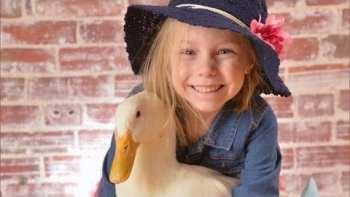 Little Girl And Her Pet Duck Are The Cutest