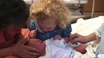 Toddler Adorably Soothes, Reassures Her New Born Baby Sister