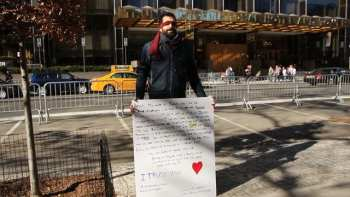 Standing Blind In Central Park With A Sign: I Trust You