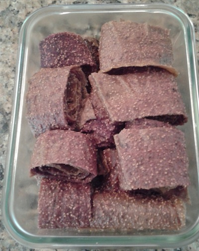 The finished product, a sheet of dried fig, rolled up and sliced into single servings. I keep them in a sealed, glass container.