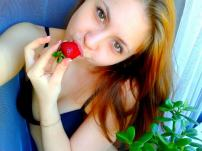 cam girl sucking on a strawberry